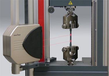 Zwick's latest laserXtens® non-contact extensometer operating without specimen marks.