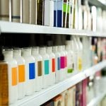shampoo products on a shelf - learn about structured surfactant technology