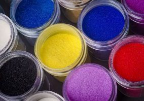 41997995 - a lot of multicolored paint in jars for makeup artistry